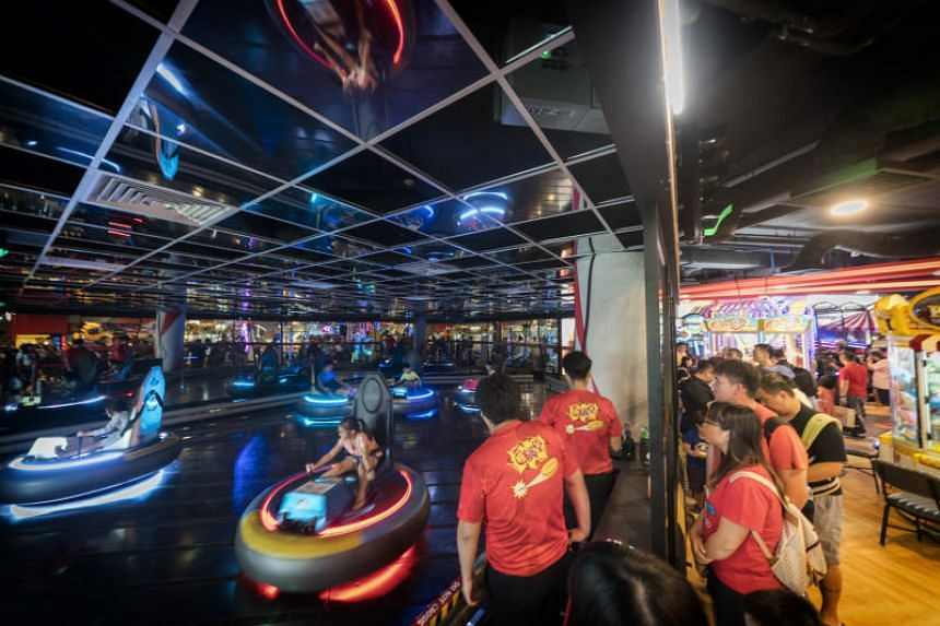 Malls are making room for yoga studios, boxing gyms and climbing walls. At VivoCity, Mapletree Commercial Trust added an arcade complete with a full-sized bumper car ring.