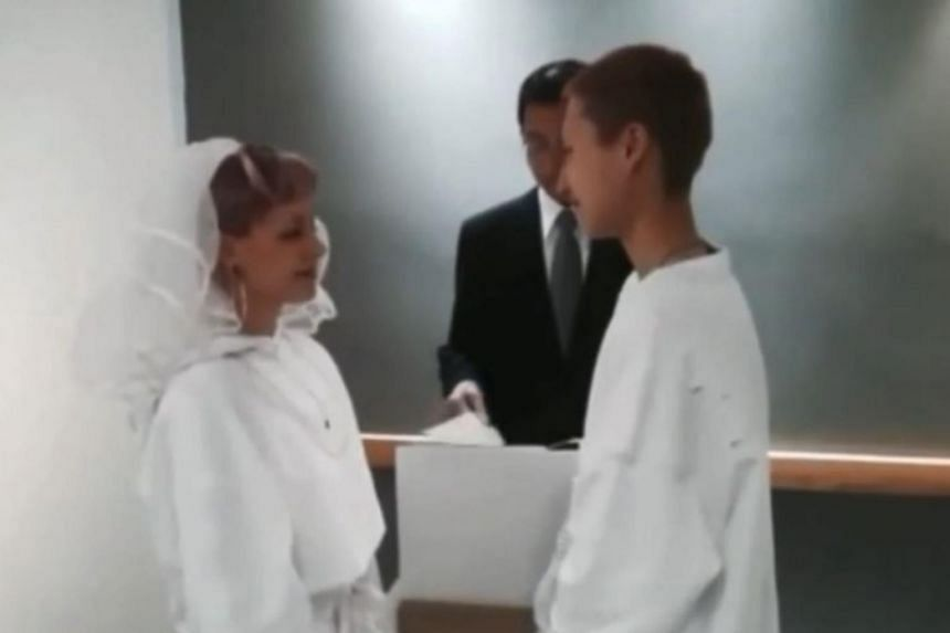 Andi Autumn (left) and Etta Ng at their wedding ceremony.