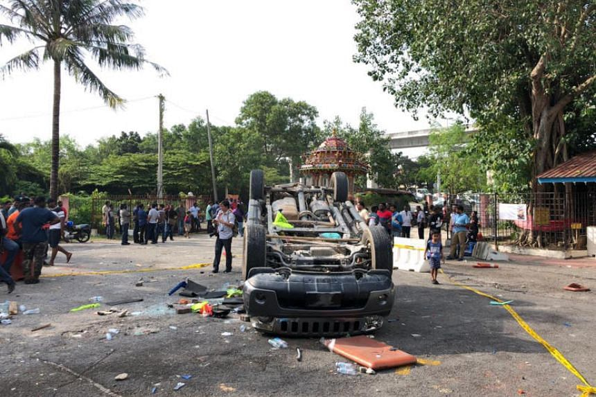 Cars set on fire as clash breaks out over relocation of temple in