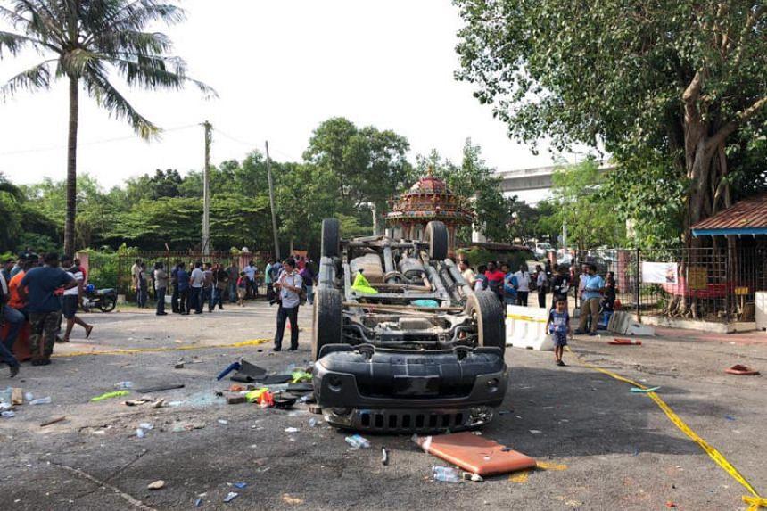 A burnt car at the Sri Maha Mariamman temple in Subang Jaya, Selangor, on Nov 26, 2018, following scuffles involving some 50 men.