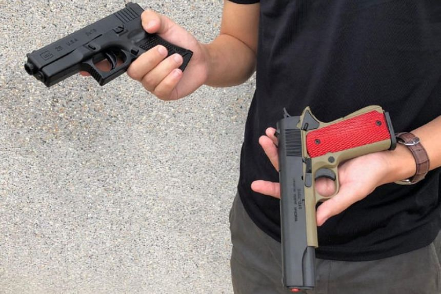 Replicas of a Glock pistol (left) and 1911 pistol (right). Every gun or replica gun has to be declared to the authorities, and owners must obtain licences for them.