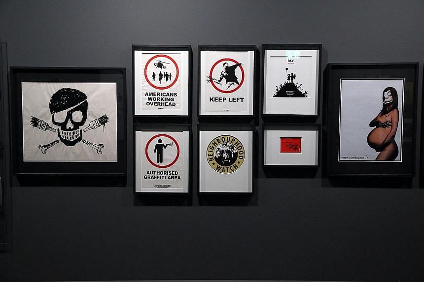 The exhibition puts together around 80 of Banksy's works, including paintings, sculptures and prints, as well as record and CD covers he has designed.
