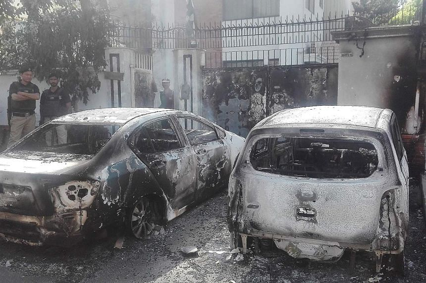 Burnt-out vehicles outside the Chinese consulate in Karachi after an attack last Friday. As Pakistan becomes more indebted to China and an economic crisis worsens, anger is brewing among the locals.