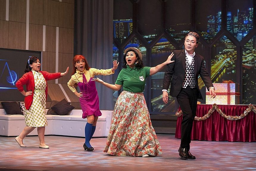 Sebastian Tan as a multimillionaire Scrooge with (from far left) Candice de Rozario, Audrey Luo and Siti Khalijah Zainal as the three ghosts who appear to get him into the Christmas spirit.