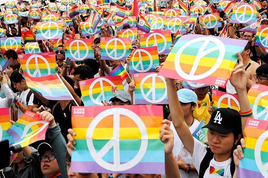 Same-sex marriage supporters in Kaohsiung taking part in a lesbian, gay, bisexual and transgender parade on Sunday after losing in Taiwan's marriage equality referendum the day before. The gay rights issue has become one of the most divisive in Taiwa
