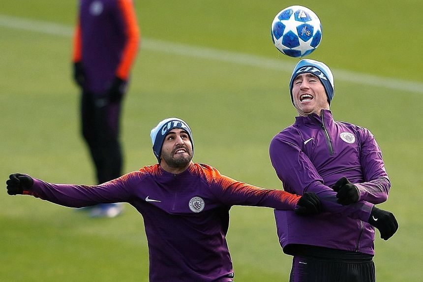 Manchester City's Riyad Mahrez (far left) and Aymeric Laporte during training ahead of today's away Champions League clash with Lyon. City need only a draw to seal their place in the last 16 of the competition.