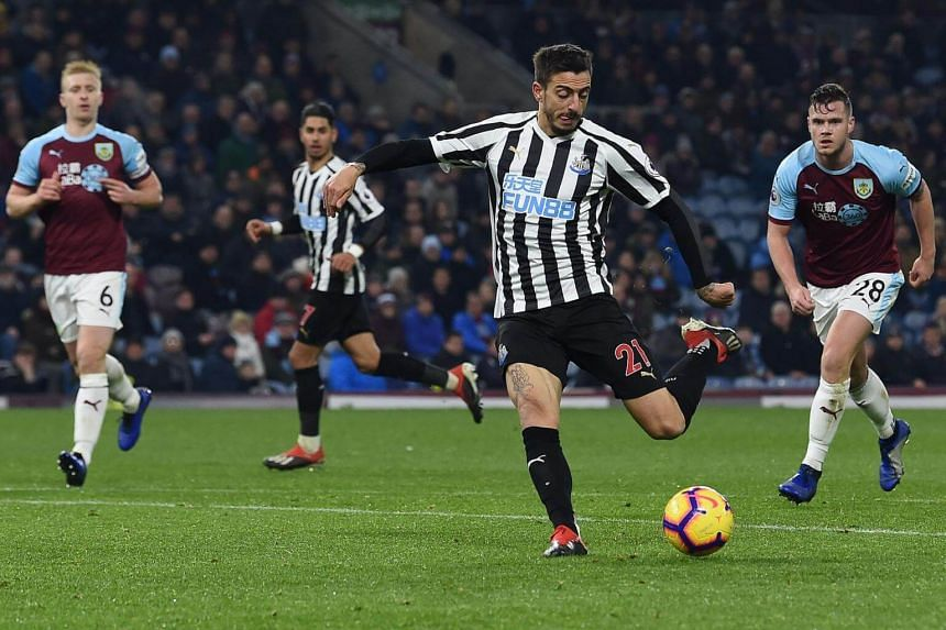 Newcastle United's Spanish striker Mato Joselu shoots but fails to score during the EPL match between Burnley and Newcastle United at Turf Moor in Burnley, north west England, on Nov 26, 2018.