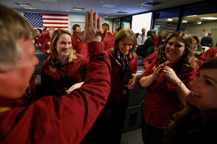Engineers celebrate in the space flight operation facility at Nasa's Jet Propulsion Laboratory in California after the spaceship InSight landed on the surface of Mars on Nov 26, 2018.