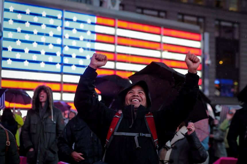 People in New York City's Times Square cheer as Nasa's InSight spaceship lands on Mars after a six-month journey on Nov 26, 2018.