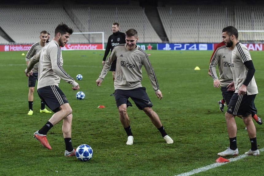 AFC Ajax's Klaas Jan Huntelaar (left) passes the ball to Donny van de Beek during a training session at Athens' Olympic Stadium, on Nov 26, 2018.