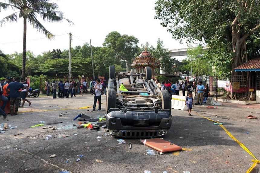 -An overturned vehicle at the temple in Subang Jaya, Selangor, after violence erupted between attackers and Hindu devotees on Nov 26, 2018.