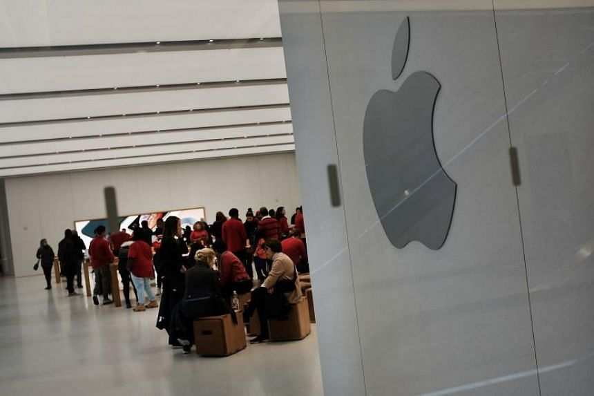 People stand in an Apple store in lower Manhattan in New York City, on Nov 20, 2018.