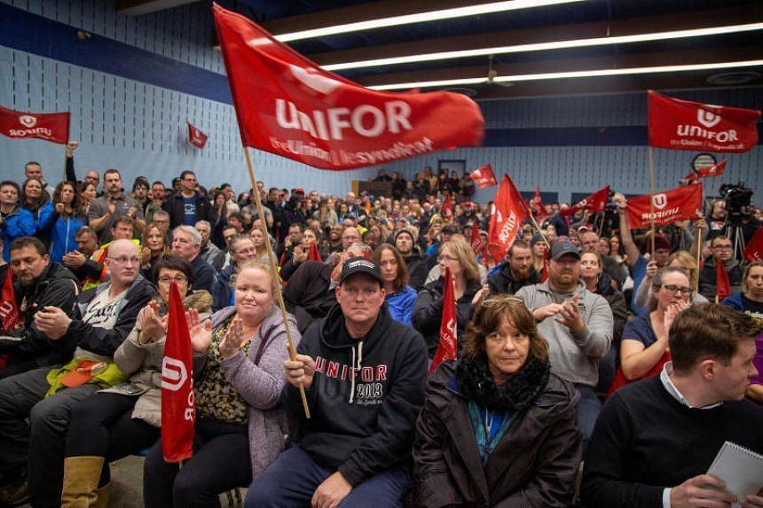 General Motors workers gather for a meeting at UNIFOR Local 222 near the General Motors' assembly plant in Oshawa, Ontario, Canada, on Nov 26, 2018.