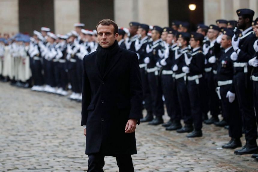 French President Emmanuel Macron attends a military ceremony at the Invalides in Paris, on Nov 26, 2018.