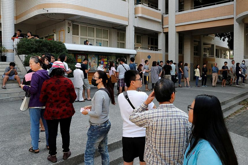 Citizens queue to cast their votes at a polling station for a referendum in Kaohsiung, Taiwan on Nov 24, 2018.