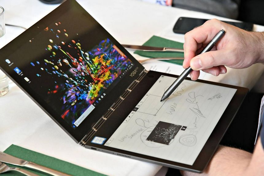Lenovo's new Yoga Book C930 features two screens, including an E Ink screen that can double as a sketch pad and e-book reader.