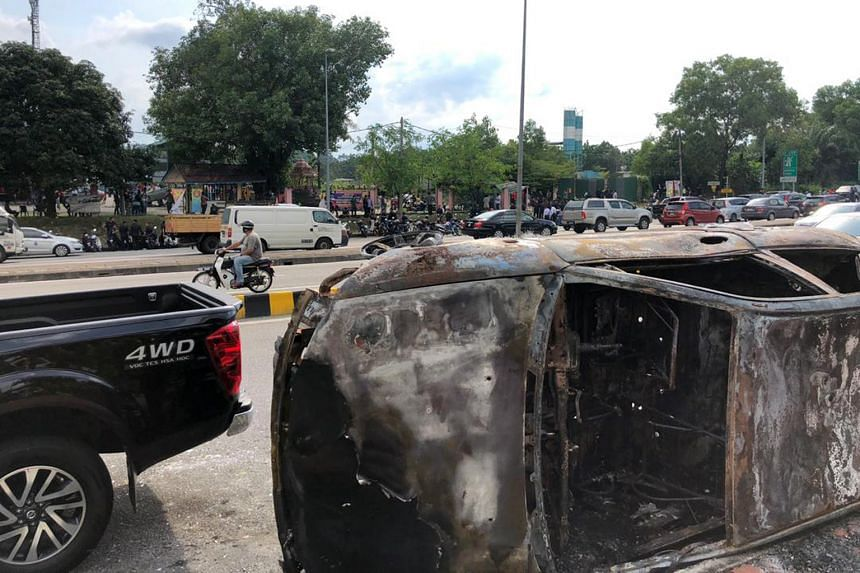 Vehicles were also torched during the scuffle.