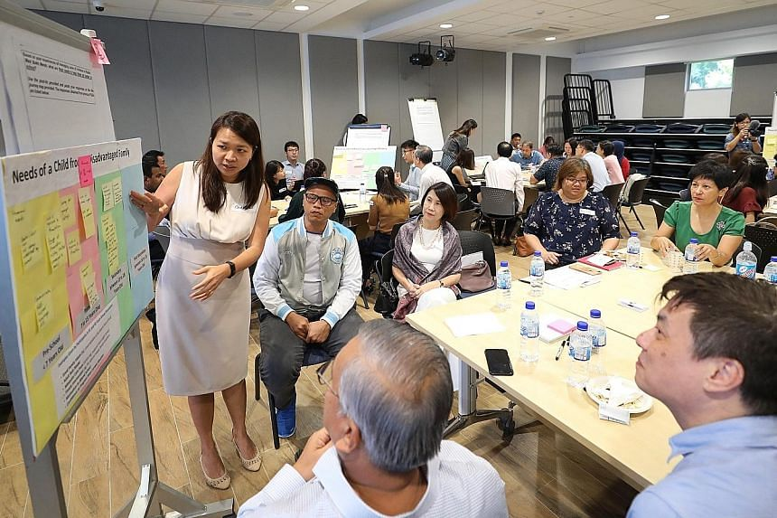 Second Minister for Education Indranee Rajah (in green), who heads Uplift, at a group discussion with participants, most of whom were social workers, at the inter-agency task force's idea-sharing session yesterday at Radin Mas Community Club.