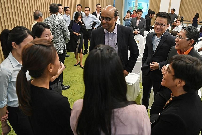 The book retails at $36 excluding GST at all major bookstores. A digital version sells for $14 excluding GST on publisher World Scientific's website. Clockwise from centre: Deputy Prime Minister Tharman Shanmugaratnam, Singapore Management University