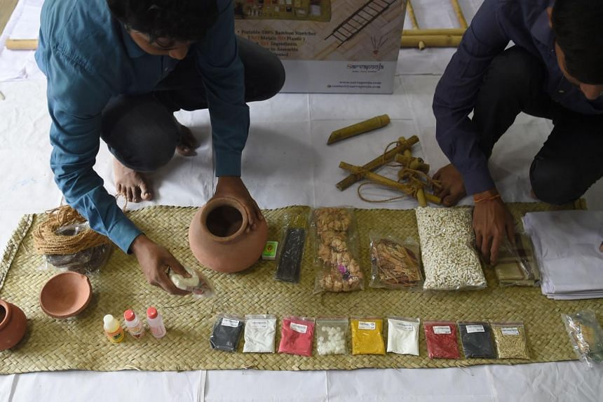 "Workers arrange the various materials of a ""final rites kit"" at SarvaPooja's manufacturing unit in Mumbai."