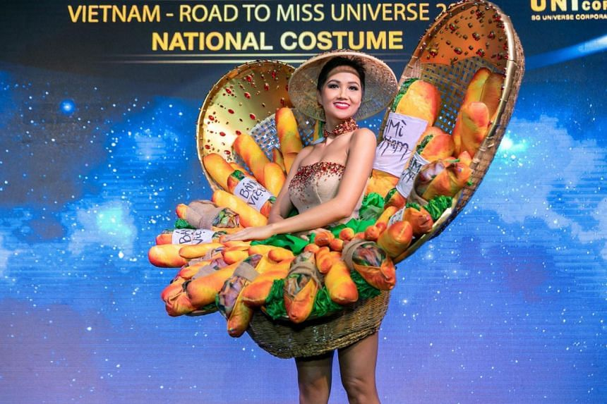 In photos Ms H'Hen Nie posted on her social media accounts on Nov 22 when she unveiled her outfit, she appears to be hemmed in by three baskets of baguettes, some clamping meat and vegetable fillings.