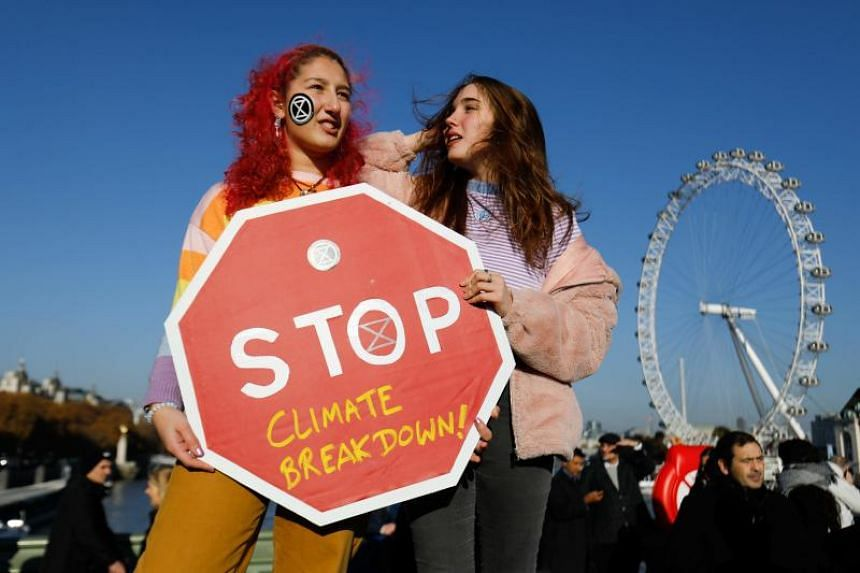 Demonstrators take part in a pro-environment protest as they block Westminster Bridge in central London on Nov 17, 2018