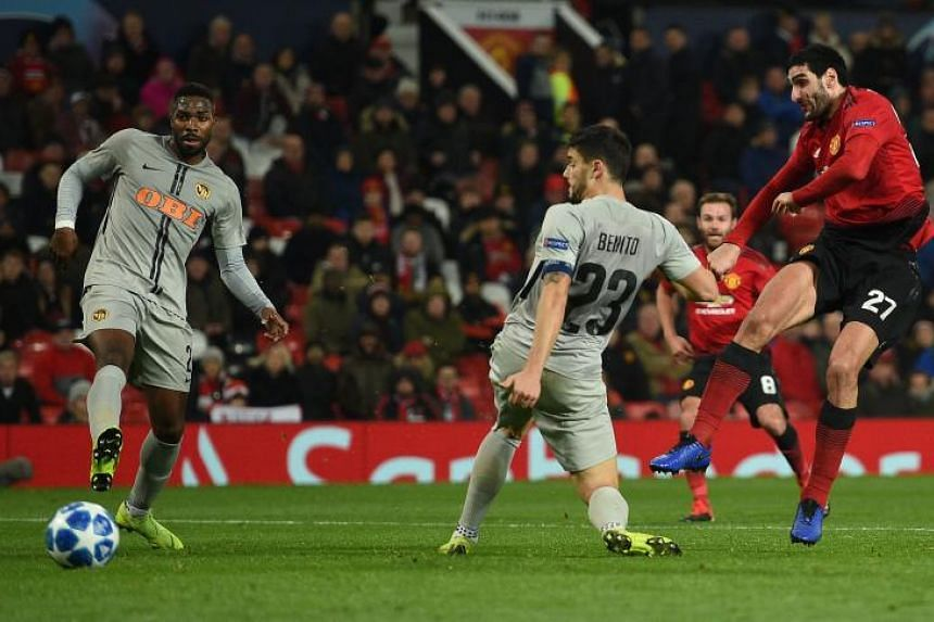 Manchester United's Belgian midfielder Marouane Fellaini (right) scores the opening goal during the UEFA Champions League group H football match between Manchester United and Young Boys at Old Trafford in Manchester, north-west England on Nov 27, 201