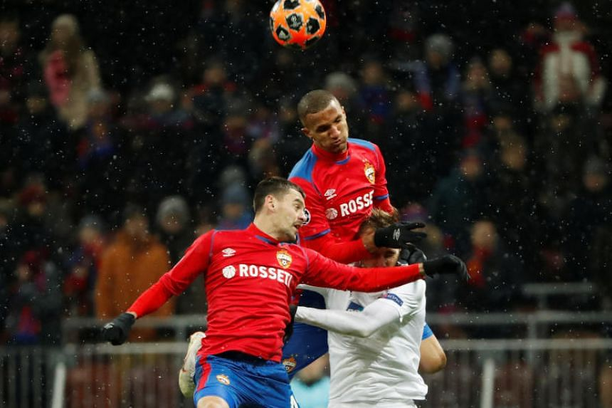 CSKA Moscow's Georgi Shchennikov and Rodrigo Becao in action with Viktoria Plzen's Tomas Chory.
