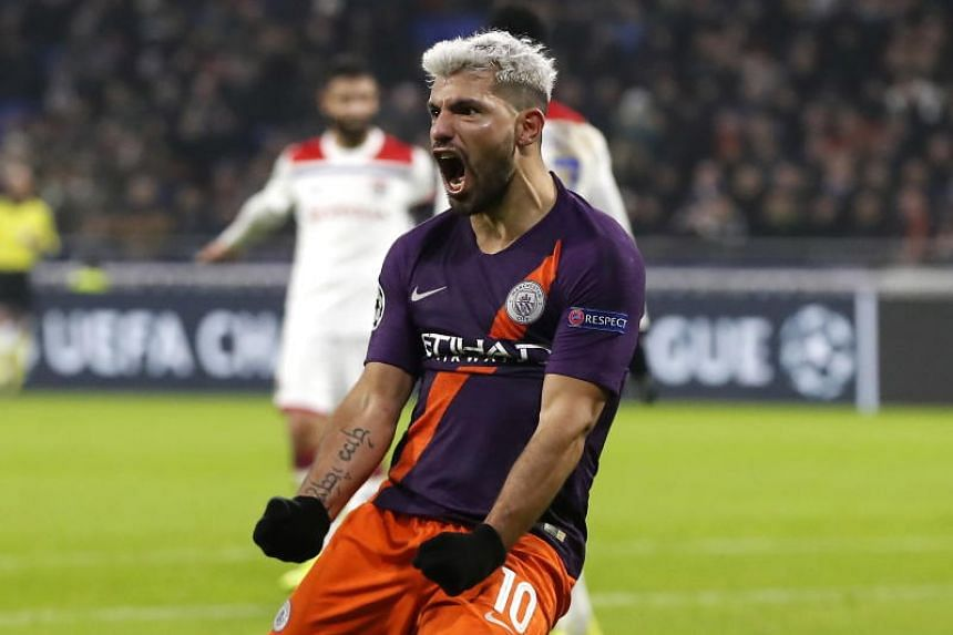 Sergio Aguero (left) of Manchester reacts after scoring during the Uefa Champions League Group F soccer match between Olympique Lyon and Mancherster City, in Decines-Charpieu near Lyon, France, on Nov 27, 2018.