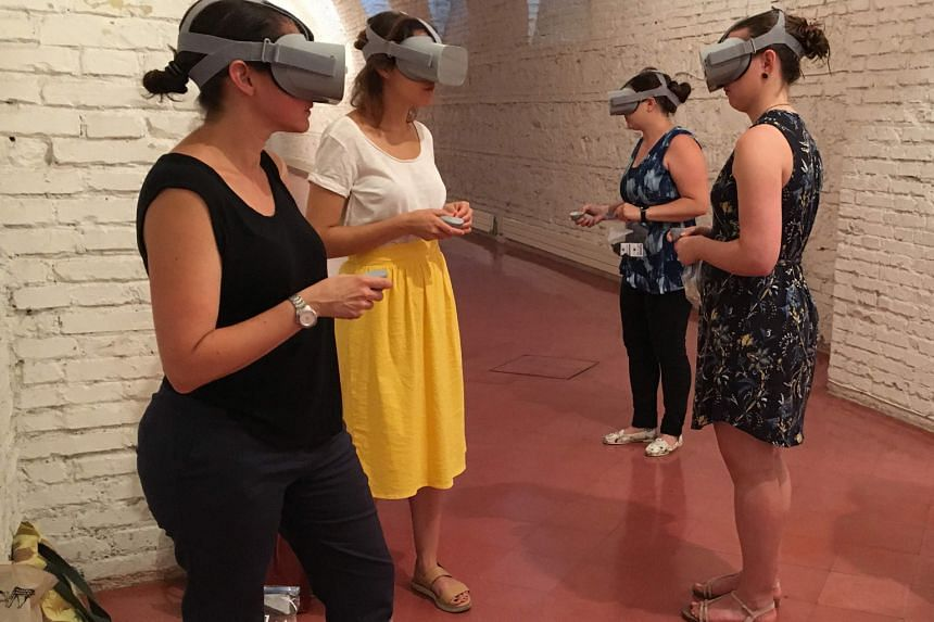 Users (above) of the Rome Reborn virtual reality tour viewing digital reconstructions of the ancient city of Rome, featuring more than 7,000 buildings and monuments from AD320.