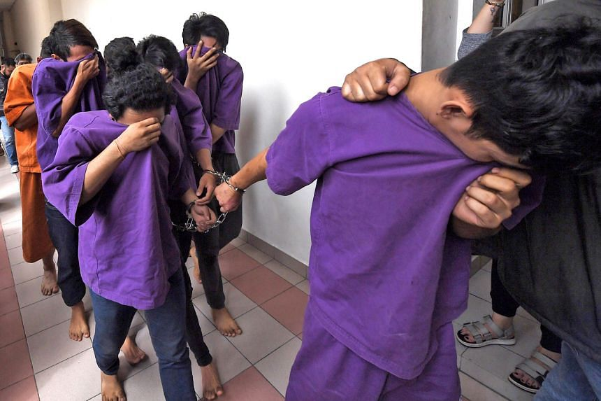 Suspects at the Petaling Jaya Magistrate's Court, where a remand order was issued yesterday against 16 individuals. A total of 21 people were arrested in relation to the violence at Sri Maha Mariamman Temple in Subang Jaya. Malaysian Prime Minister M