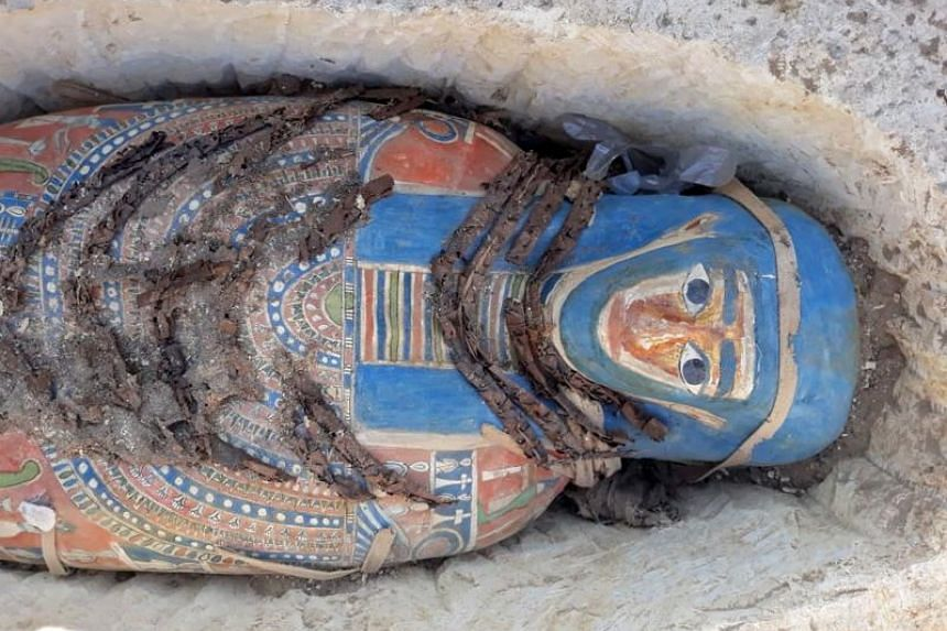 Newly-uncovered mummies dating back over 2,300 years were found by Egyptian archaeologists at a pyramid complex south of Cairo.