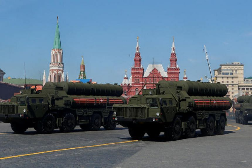 Russian servicemen drive S-400 missile air defence systems during ceremonies in Red Square, Moscow, on May 9, 2018.