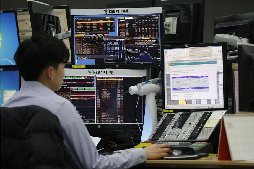 A South Korean dealer works in front of monitors at the KEB Hana Bank in Seoul, South Korea, Nov 26, 2018