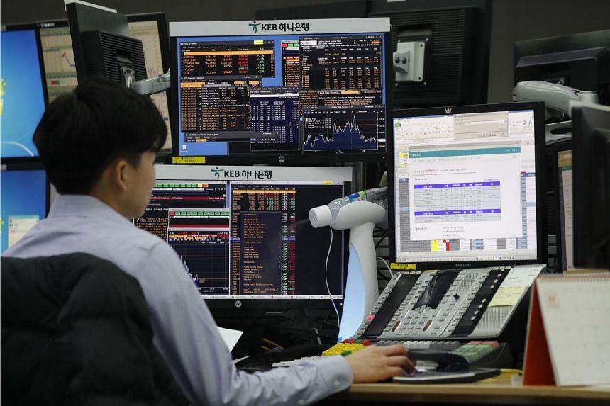 A South Korean dealer works in front of monitors at the KEB Hana Bank in Seoul, South Korea, Nov 26, 2018