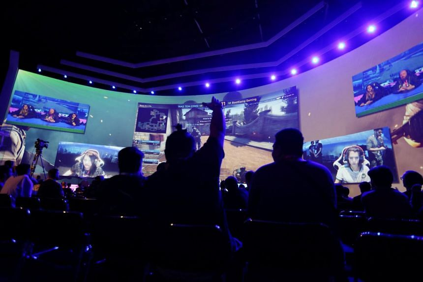 Audience members watch an e-sports tournament during the Game XP 2018 at the Olympic Park in Rio de Janeiro, Brazil Sept 6, 2018