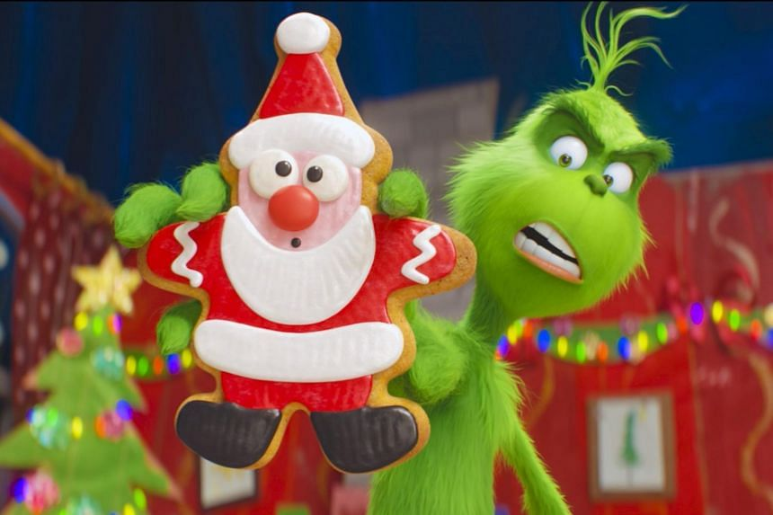 The Grinch (voiced by Benedict Cumberbatch) is unabashedly cheerful, cute and kid-friendly, unlike the 2000 live-action version.