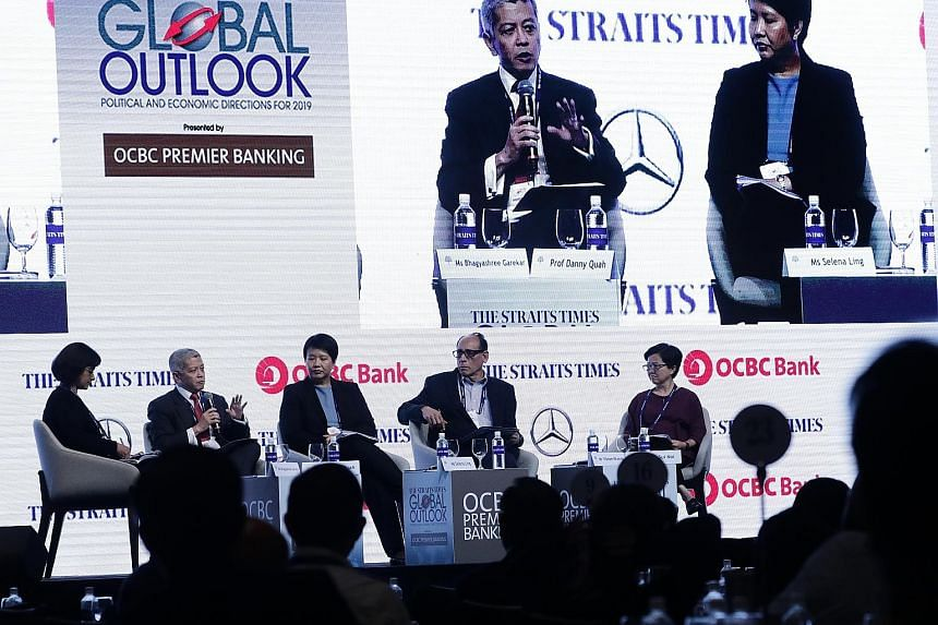 (From far left) Moderator and ST deputy foreign editor Bhagyashree Garekar; Lee Kuan Yew School of Public Policy dean Danny Quah; OCBC Bank's head of treasury research and strategy Selena Ling; ST associate editor Vikram Khanna; and ST East Asia edit