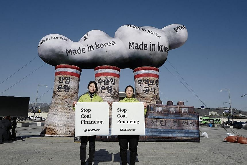 Greenpeace activists in Seoul protesting against the use of coal. The new EU strategy does not propose changing its 2030 goal, but it sets seven building blocks for the following decades that could be turned into binding targets.