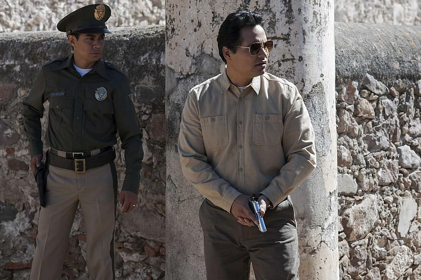 Michael Pena (right) plays a cop in Narcos: Mexico, which is based on real events and people involved in the Mexican drug trade.