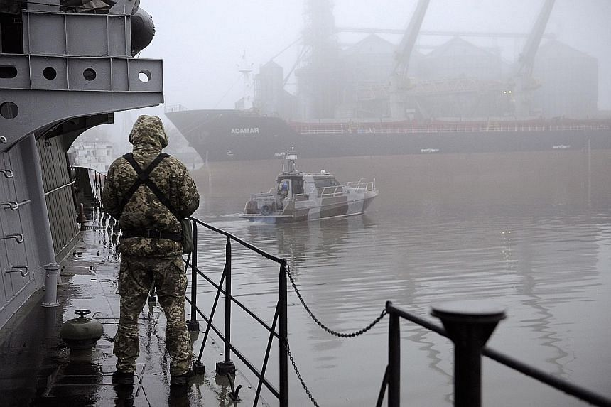 A Ukrainian soldier aboard a military boat in the Sea of Azov on Tuesday. Russia had seized three Ukrainian navy vessels.