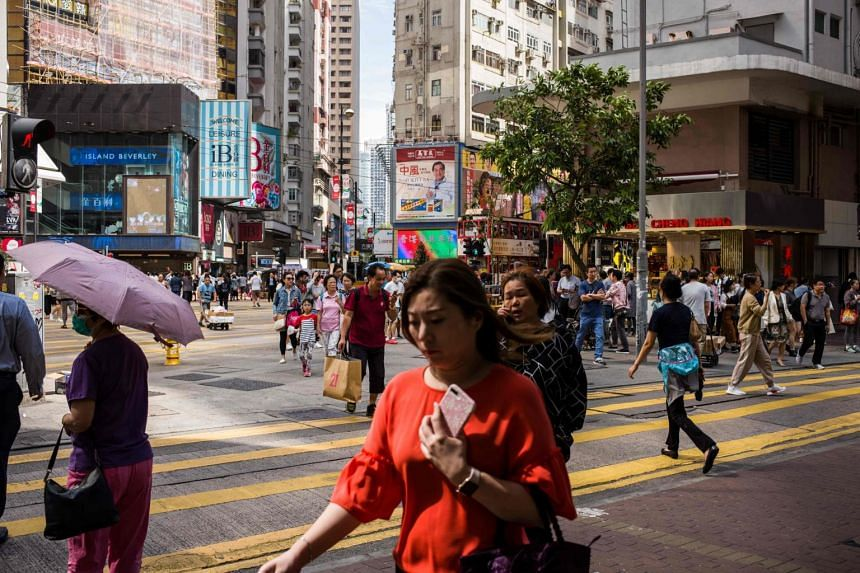 Pedestrians in the shopping district of Causeway Bay in Hong Kong, on Nov 1, 2018. In mid-November, the government recalibrated its estimates for 2018 to 3.2 per cent from the previous 3 to 4 per cent estimate.