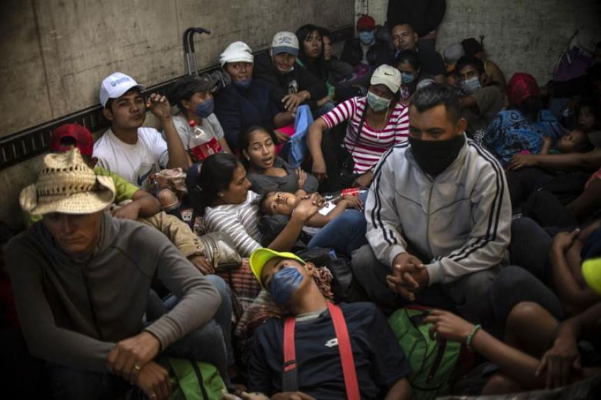 Central American migrants - mostly Hondurans - moving in a caravan towards the United States in hopes of a better life, travel in a truck from Mexicali to Tijuana, Mexico on Nov 27, 2018.