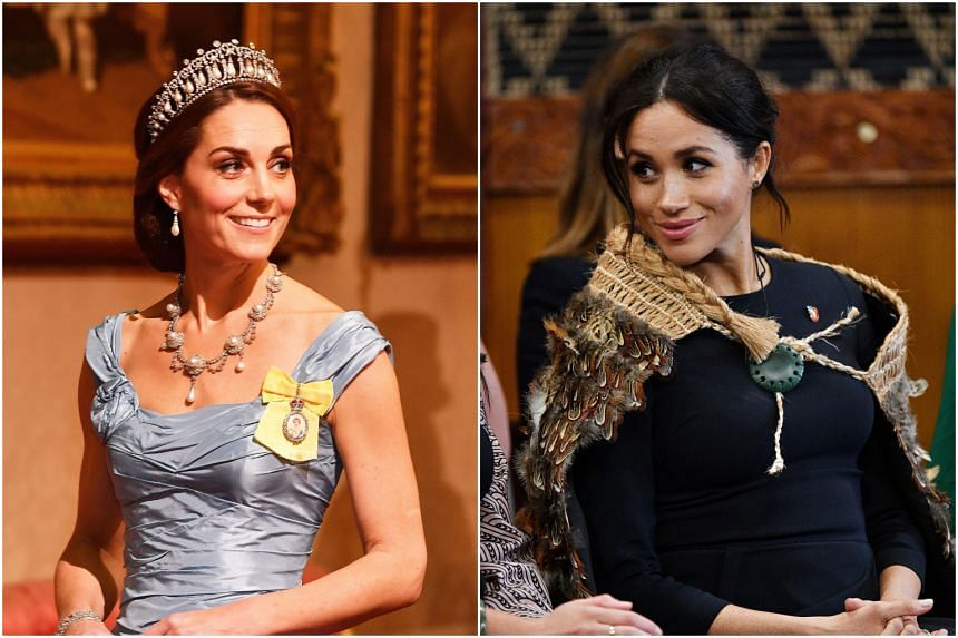 Meghan Markle (right) allegedly reduced her sister-in-law, Kate Middleton, into tears at the fitting for Princess Charlotte's bridesmaid dress.
