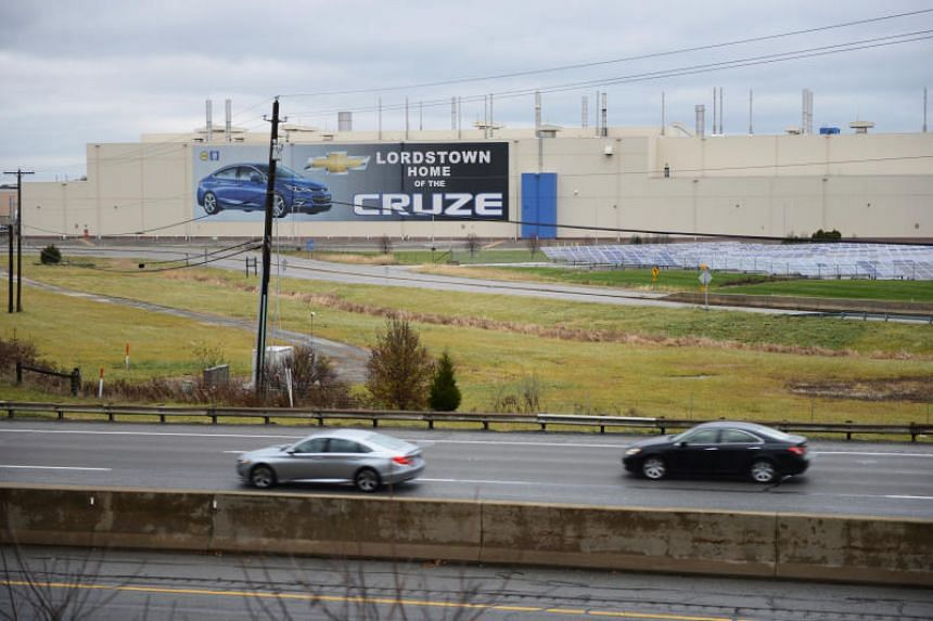Cars pass the General Motors Lordstown Complex, assembly plant in Warren, Ohio, US, on Nov 26, 2018.