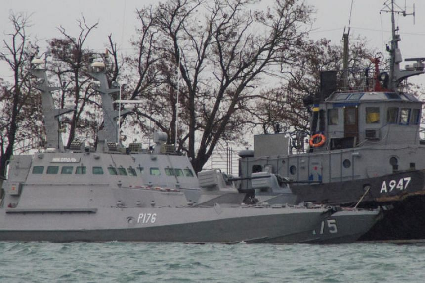Ukrainian naval ships, which were recently seized by Russia's FSB security service, are seen anchored in a port in Kerch, Crimea, on Nov 28, 2018.