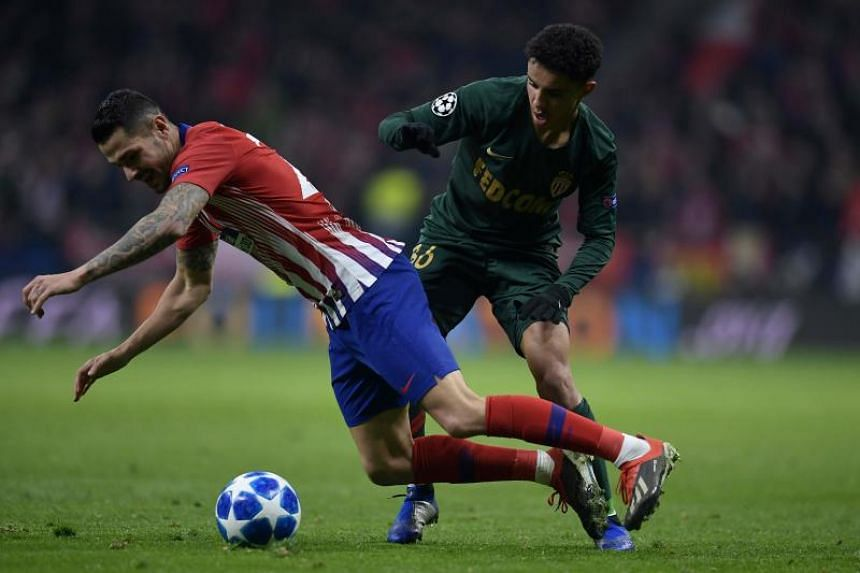 Atletico Madrid's Spanish forward Vitolo (left) vies for the ball with Monaco's French midfielder Sofiane Diop during the UEFA Champions League group A match between Atletico Madrid and Monaco at the Wanda Metropolitan stadium in Madrid, on Nov 28, 2