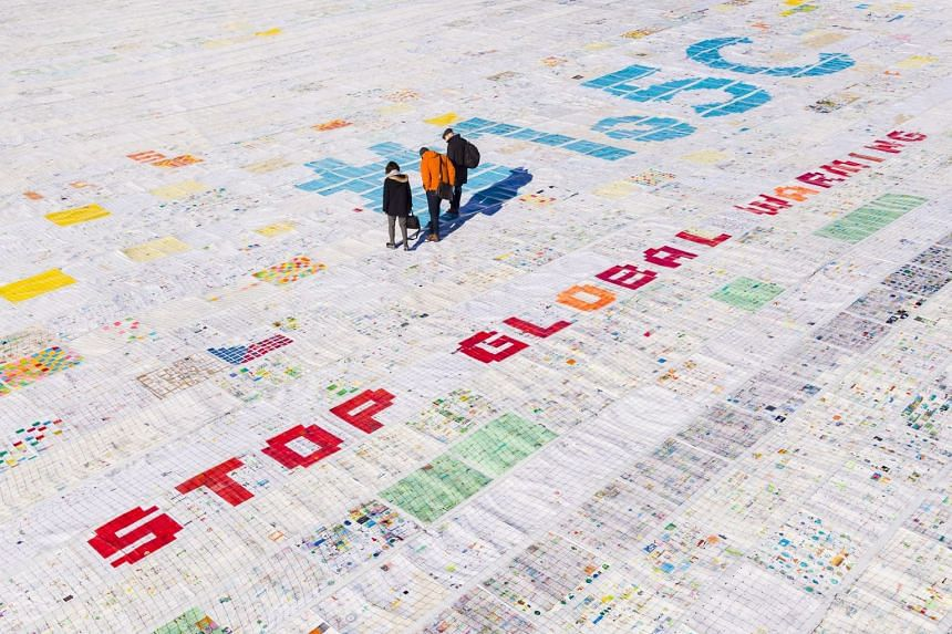 A giant image of approximately 2,500 sq m and made of contributions from over 125,000 postcards containing messages aiming to fight climate change and global warming, is seen on the Aletsch glacier near the Jungfraujoch saddle by the Jungfrau peak, S