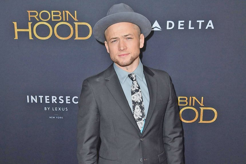 Taron Egerton, the latest actor to play Robin Hood, likes the political element in the new film, but says it is ultimately meant to entertain. Taron Egerton is Robin and Jamie Foxx is Little John in Robin Hood.