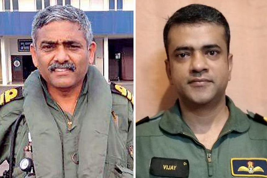 Captain P. Rajkumar (left) and Commander Vijay Varma were among India's navy pilots who undertook high-risk missions to save people from rooftops and isolated land as the southern state of Kerala battled a flood crisis in August. The AHA Centre was e